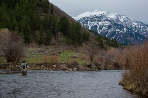 winter fly fishing offers solitude and views of snow covered peaks